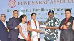 CRPF DIG BK Toppo (C) giving a cheque of Rs 1 lakh to Neeraj Yadav, wife of soldier Pradip Sing Yadav, in presence of PSA President Fatehchand Ranka