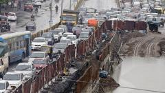 City hit by traffic chaos with waterlogging, closed roads