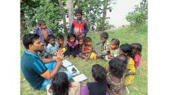 A special educator with children from Kasurdi village of Bhor taluka in activity-based learning.