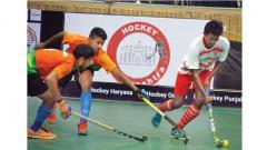 A player from Tamil Nadu (white) controls the ball during their match against Maharashtra in the Hockey India 5-a-side Senior National Hockey Championship on Tuesday.