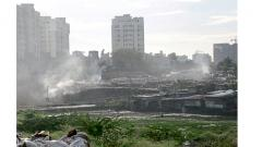 A file photo of garbage being burnt in a  huge pile which is created due to illegal dumping by the Wagholi gram panchayat.