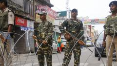 Paramilitary personnel stand guard during restrictions in Jammu, Friday, Aug 9, 2019.