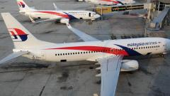 Malaysia suspected MH370 downed in murder-suicide