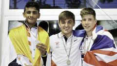 Siddhant Khopade (left) poses with two other medallists during the FISEC Games in Lignano, Italy.