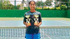 Vaishnavi Adkar poses with her trophies after winning the Under-14 National Series Tennis Tournament.