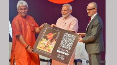 Prime Minister Narendra Modi receives his Q card from Telecom Minister Manoj Sinha during the launch of India Post Payments Bank (IPPB), in New Delhi on Saturday.