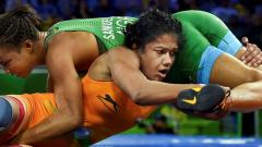India's Babita Kumari (Red) wrestles with Nigerias Bose Samuel in the Womens Freestyle 53 kg Nordic System match at the Commonwealth Games 2018 in Gold Coast, on Thursday. Manvender Vashist/PTI
