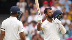 Pujara ton boosts India on Day 1