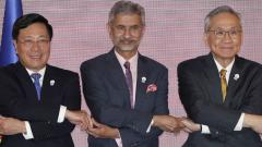Vietnam's Foreign Minister Phm Binh Minh (L), India's External Affairs Minister S Jaishankar (C)  and Thailand's Foreign Minister Don Pramudwinai pose together at the start of the India-ASEAN Foreign Ministers' Meeting in Bangkok, Thailand, on Thursday.