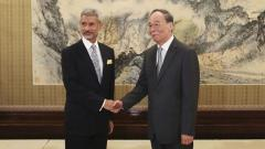External Affairs Minister Subrahmanyam Jaishankar shakes hands with China's Vice President Wang Qishan during a meeting at Diaoyutai State Guesthouse, in Beijing, on Monday.