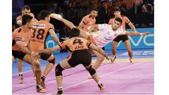 Puneri Paltan raider Rohit Kumar Choudary tries to touch U Mumba player with a kick during PKL Season 5 match at The Dome on Saturday.