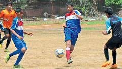 Players of Kasturba Gandhi English Medium School (in black) in action against Angel Mickey Minie School at SSPMS ground on Friday.