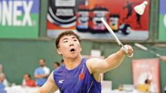 Guo Xinwa of China in action against Kim Moon Jun of Korea on Friday.
