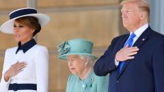 Queen Elizabeth II stands with US President Donald Trump and First Lady Melania Trump as they listen to the US national anthem during a welcome ceremony at Buckingham Palace in London on June 3, 2019. AFP Photo