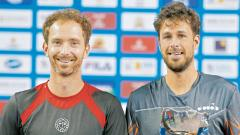 Netherlands' Robin Hasse (right) and Matwe Middelkoop pose after winning their Tata Open Maharashtra doubles' trophy