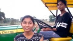 Farmer's two teenaged daughters learn to drive tractor