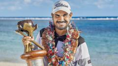 Gaganjeet Bhullar poses with the trophy after winning his maiden European Tour title for a one-stroke win over Anthony Quayle.