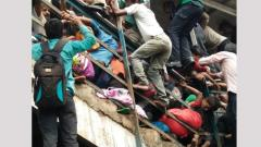 Commuters struggle during the stampede at Elphinstone Road railway station in Mumbai on Friday.