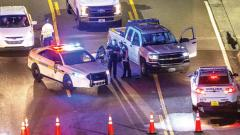 A heavy police presence remains into the night at the shooting outside Jacksonville Landing on Sunday in Jacksonville, Florida. A shooting rampage during a Madden 19 video game tournament at the site claimed four lives, with several others wounded.
