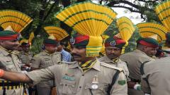 A paramilitary force member takes a selfie on a phone before marching during Independence Day celebrations in Agartala, the capital of the northeastern state of Tripura, on August 15, 2017.