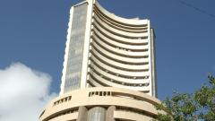 Equity indices close on flat-to-positive note; capital goods stocks rise