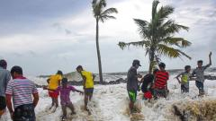 Boys play in the water as the Arabian Sea storms to the shores at Kannamaly near Kochi, on June 10, 2019. PTI Photo