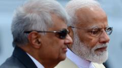 Sri Lankan Prime Minister Ranil Wickremesinghe (L) stands next to Indian Prime Minister Narendra Modi (R) during a welcoming ceremony at the Bandaranaike International Airport in Katunayake on June 9, 2019.