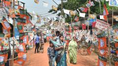A street with flags and banners of political parties fixed on both sides of the road near a polling station, during voting for the sixth phase of Lok Sabha polls, at Ghatal in West Midnapore district of West Bengal, on May 12, 2019. PTI Photo