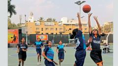 Players of Sardar Dastur High School (in orange) in action against Chonde Patil Basketball Academy