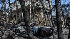 A photo taken on  Wednesday shows cars burnt following a wildfire in the village of Mati, near Athens.