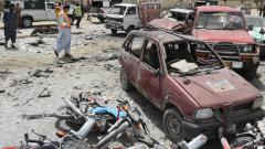 Pakistani security personnel gather at the site of a suicide attack near a polling station in Quetta on Wednesday.