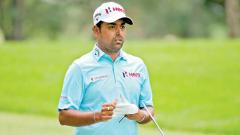 Anirban Lahiri of India walks across the 18th hole during World Golf Championships-Bridgestone Invitational - Round One at Firestone Country Club South Course on August 2.