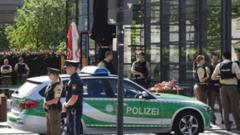 Police officers secure the area around a commuter rail station in Unterfoehring near Munich, southern Germany, where shots were fired on June 13, 2017.