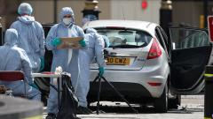 A car on Tuesday crashed into security barriers outside the UK's Parliament at speed, injuring two persons, Scotland Yard said as its counter-terror unit arrested a man on suspicion of terrorism offences.
