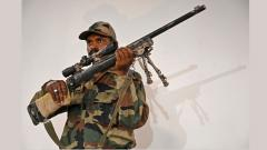 An Indian soldier shows a snipper gun during a press conference at the Army headquarters in Srinagar on Friday.