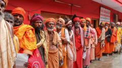 Sadhus wait in a queue to get themselves registered for Amarnath Yatra at a base camp, in Jammu on Saturday, June 30, 2018. PTI Photo