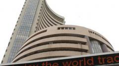 Equity indices end in red on global cues, weak rupee