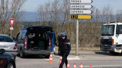 French gendarmes block the access to Trebes, where a man took hostages at a supermarket on March 23, 2018 in Trebes, southwest France. AFP/Eric Cabanis