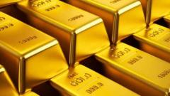 Gold retreats from record high amid economic uncertainty