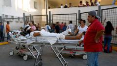 Patients and staff remain outside the regional hospital during a powerful earthquake in Veracruz, Mexico on February 16, 2018. Photo- Victoria Razo/AFP