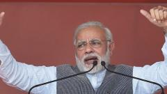 Prime Minister Narendra Modi addesses an election campaign rally in Sanand, Gujarat