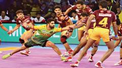 Patna Pirates captain and raider Pradeep Narwal in action against UP Yoddha at The Arena Stadium in Ahmedabad.