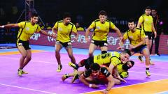 Ajay Kumar of Bengaluru Bulls tries to touch mid-line playing against Telugu Titans in the Pro kabaddi League Season 5 match at Harivansh Tana Bhagat Indoor Stadium in Ranchi on Saturday.