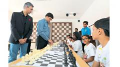 Viswanathan Anand (second from left) plays chess with the kids during the launch of Evolve an edu-infotainment centre of ChildCentric Homes by Gera Developments. Also seen is Rohit Gera, Managing Director, Gera Developments.