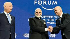 Prime Minister Narendra Modi (C) with President of the Swiss Confederation, Alain Berset (R) and the Chairman of the World Economic Forum, Klaus Schwab, at the plenary session of World Economic Forum, in Davos.