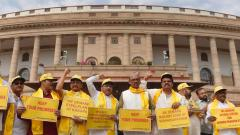 TDP party leaders hold placards and raise slogans demanding special status for the state of Andhra Pradesh during the budget session, at Parliament House in New Delhi on Wednesday. Photo/Atul Yadav/PTI