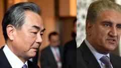 A combination of photo of Chinese Foreign Minister Wang Yi (L) and Pakistan's Foreign Minister Shah Mahmood Qureshi (R).