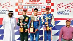 (from left) Felipe Drugovich, Presley Martono, Rinus van Kalmthout pose with their trophies. Also seen is Arun Mammen, Vice Chairman and MD, MRF Tyres.