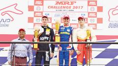(from left) Arun Mammen, Vice Chairman and MD, MRF Tyres, Louis Gachot, Rinus van Kalmthout and Julien Falchero pose on the podium