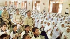 Commissioner of Police Dr K Venkatesham (Front Centre), Add CP Ashok Morale and DCP Swapna Gore visit Rafi Ahmed Kidwai Urdu High School on the occasion of Teachers' Day in Bhavani Peth on Thursday.